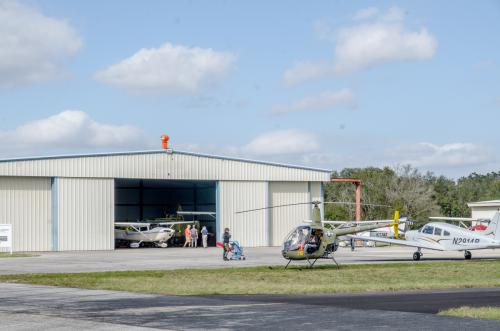 Hanger with airplanes and a helicopter