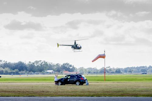 Helicopter in flight as a spectator waves